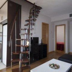 Отель Apartamentos Atocha Испания, Мадрид - отзывы, цены и фото номеров - забронировать отель Apartamentos Atocha онлайн удобства в номере фото 2