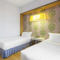 Отель NH Milano Touring 4* Стандартный номер разные типы кроватей фото 11