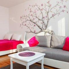 Апартаменты Stay In Apartments комната для гостей фото 3