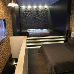Отель Chambre Avec Jacuzzi Sauna Privatif Улучшенные апартаменты фото 27