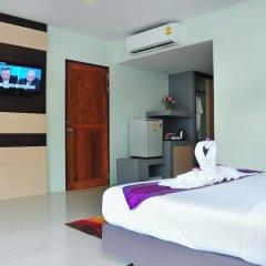 Отель AM Surin Place Номер Делюкс с двуспальной кроватью фото 6