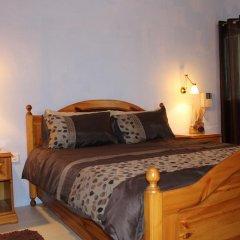 Отель South Village Townhouse Заббар комната для гостей фото 3
