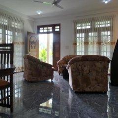 Апартаменты Coral Palm Villa and Apartment интерьер отеля