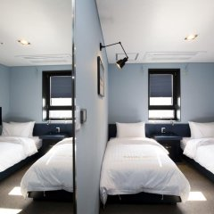 Отель Grid Inn 2* Стандартный номер с 2 отдельными кроватями фото 4