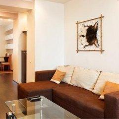 Апартаменты VIP Apartments в центре комната для гостей фото 3