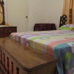 Отель Tina's Guest House в номере