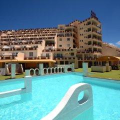 Отель Apartamentos Palm Garden бассейн