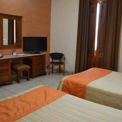 Отель Santiago De Compostela Hotel Мексика, Гвадалахара - отзывы, цены и фото номеров - забронировать отель Santiago De Compostela Hotel онлайн удобства в номере