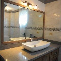 Отель Mango Walk Country Club Suites ванная