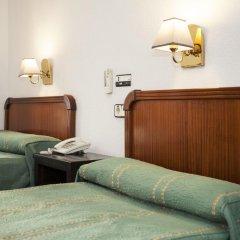 Отель Pension Carrera удобства в номере