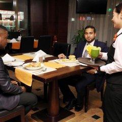 Corp Executive Hotel Doha Suites питание фото 3