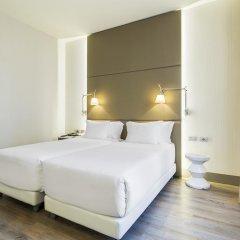 Отель NH Milano Touring 4* Улучшенный номер разные типы кроватей фото 21
