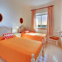 Апартаменты Inn the Beach Apartments комната для гостей фото 5
