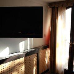 Отель Timpa Apartmanház & Dr. Strecker Villa удобства в номере