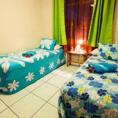 Отель Farehau Стандартный номер с 2 отдельными кроватями (общая ванная комната)