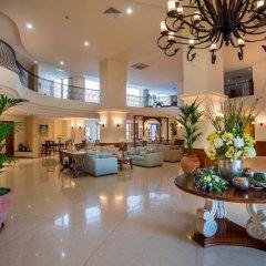 Aquamare Beach Hotel & Spa интерьер отеля