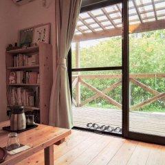 Отель Iyashi no Minshuku Tonton Якусима комната для гостей