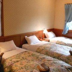 Отель Pension Flying Jeep Минамиогуни комната для гостей фото 2