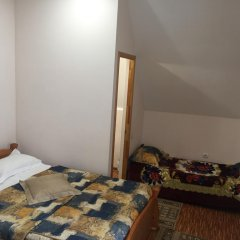 Гостиница Каприз комната для гостей