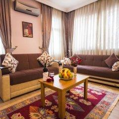 Апартаменты Feyza Apartments Семейные апартаменты с двуспальной кроватью фото 18