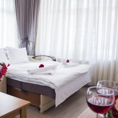 Апартаменты Feyza Apartments Студия Делюкс с различными типами кроватей фото 10
