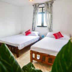 Отель M Home Guest House Стандартный номер с различными типами кроватей фото 6