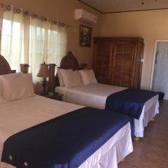 Отель Brytan Villa Ямайка, Треже-Бич - отзывы, цены и фото номеров - забронировать отель Brytan Villa онлайн комната для гостей фото 5