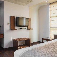 Отель Trimrooms Palm D'or 3* Номер Бизнес с двуспальной кроватью фото 7
