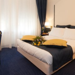 Отель IH Hotels Milano Ambasciatori 4* Улучшенный номер с различными типами кроватей фото 3