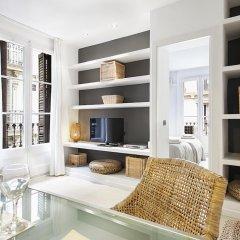 Апартаменты Habitat Apartments Barceloneta Барселона комната для гостей фото 5