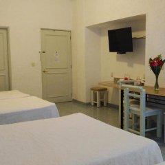 Hotel Olinalá Diamante 3* Стандартный семейный номер с двуспальной кроватью фото 5