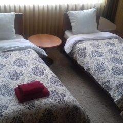 Гостиница Америго 3* Стандартный семейный номер с разными типами кроватей фото 4