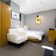 Отель Grid Inn 2* Номер Делюкс с различными типами кроватей фото 4