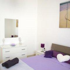 Отель Tulip Court Penthouse Буджибба комната для гостей фото 2