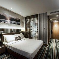 Отель The Continent Bangkok by Compass Hospitality 4* Улучшенный номер с различными типами кроватей фото 3