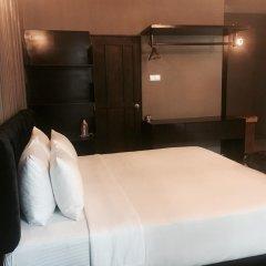 Отель Villa Raha сейф в номере