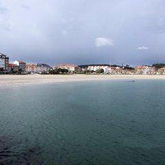 Отель Aptos Duerming Portonovo Pico пляж