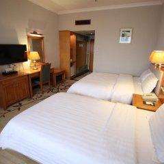 Guangzhou Hotel 3* Стандартный семейный номер с разными типами кроватей фото 4