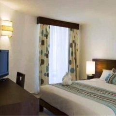 Отель Grand Paradise Playa Dorada - All Inclusive 3* Улучшенный номер с различными типами кроватей фото 3