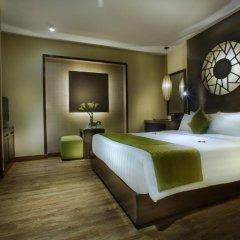 Oriental Suite Hotel & Spa 4* Улучшенный номер двуспальная кровать фото 4