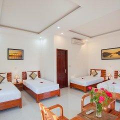 Отель Tra Que Flower Homestay Стандартный семейный номер с двуспальной кроватью фото 9