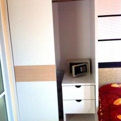Отель Risa Plus сейф в номере