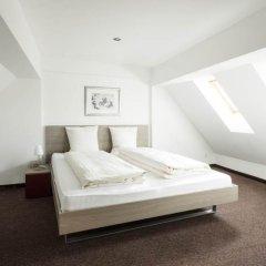 Апартаменты Ema House Serviced Apartments, Superior Standard, Unterstrass Цюрих комната для гостей фото 3