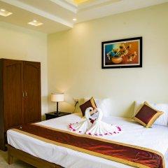 Отель Mi Kha Homestay 3* Улучшенный номер с различными типами кроватей фото 7