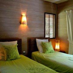 Отель Villa Honu by Tahiti Homes Французская Полинезия, Муреа - отзывы, цены и фото номеров - забронировать отель Villa Honu by Tahiti Homes онлайн комната для гостей фото 4