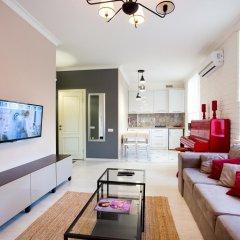 Апартаменты Lotos for You Apartments комната для гостей фото 5