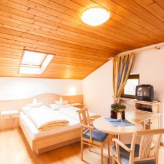Отель Appartements Kirchtalhof Лана комната для гостей фото 2