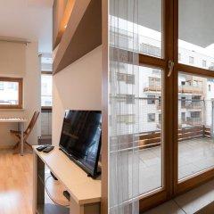 Апартаменты Bizzi LuxChelmska Apartments Варшава комната для гостей фото 2