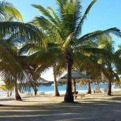 Отель Sea Eye Hotel - Sunset Building Гондурас, Остров Утила - отзывы, цены и фото номеров - забронировать отель Sea Eye Hotel - Sunset Building онлайн пляж фото 2