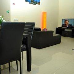 Отель Charming Holiday Lodge Мальдивы, Хулхудху (Атолл Адду) - отзывы, цены и фото номеров - забронировать отель Charming Holiday Lodge онлайн Хулхудху (Атолл Адду) интерьер отеля
